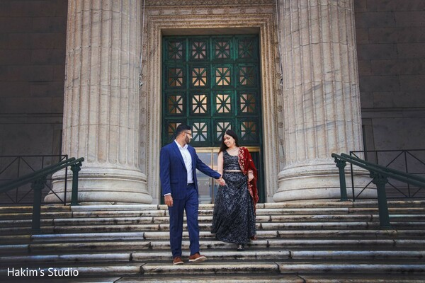 Indian couple waking down the stairs.