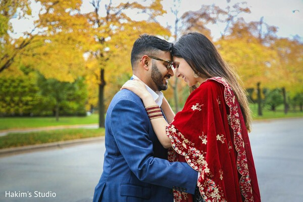 Indian couple posing outdoors for the engagement shoot.