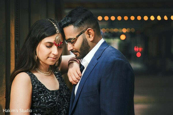 Indian couple posing outdoors for an engagement photo session.