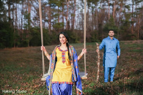 Indian bride on a swing with Indian groom.