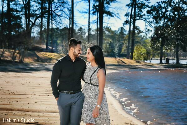Maharani and raja walking by a lake capture.