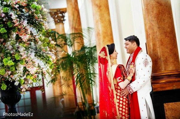 Indian bride and groom posing for a pre-wedding photo shoot.
