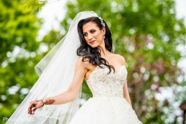 Indian bride wearing her white wedding dress.