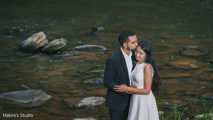 Maharani and Raja by the river engagement photo.