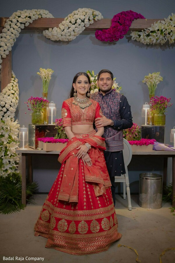 Lovely Indian bride and groom standing next to each other capture.