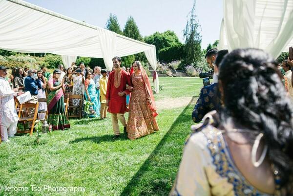 Enchanting Indian bride walking into the wedding ceremony
