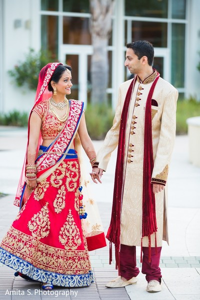 first look portraits,first look,red lengha,lengha,wedding lengha,bridal lengha