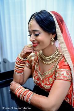 makeup,hair and makeup,updo,bridal portrait,indian bride