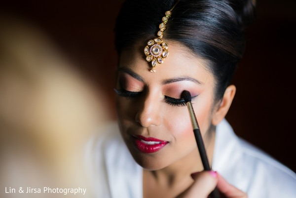 getting ready,indian bride getting ready,makeup,tikka,jewelry