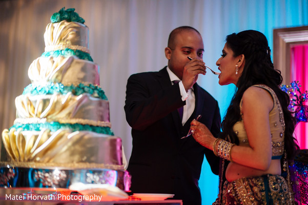 Cutting the cake in San Jose, CA Indian Wedding by Matei Horvath Photography