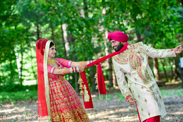 pink lengha,bride and groom,outdoor indian wedding,outdoor indian reception,sikh ceremony