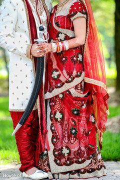 red lengha,sikh wedding,sikh ceremony,bride and groom,groom with kirpan