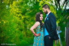 turquoise lengha,turquoise and gold lengha,bride and groom,bride and groom portrait,outdoors photography,outdoor indian photography