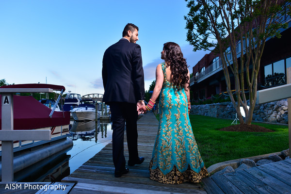 turquoise lengha,turquoise and gold lengha,bride and groom,bride and groom portrait,outdoors photography,outdoor indian photography,waterfront photography