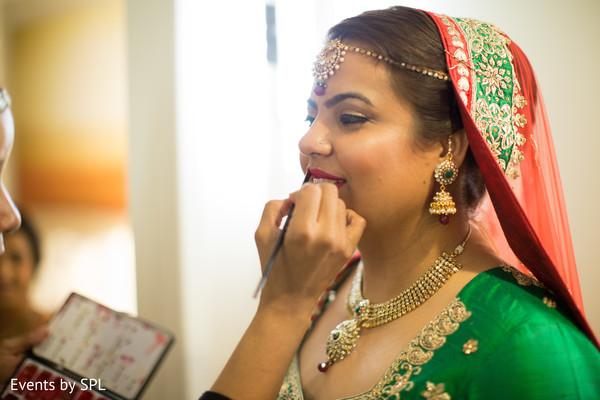 Beautiful bride getting ready in her bridal dupatta in Atlanta, GA Fusion by Events by SPL