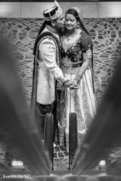 Indian bride and groom kiss portrait in Atlanta, GA Fusion by Events by SPL