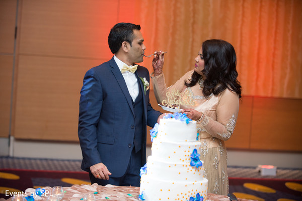 Indian couple cutting their beautiful cake in Atlanta, GA Fusion by Events by SPL