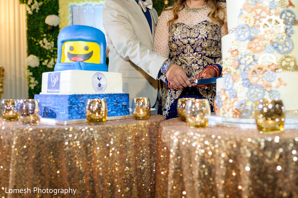 Bride and Groom cutting cake in Dallas, TX Indian Wedding by Lomesh Photography