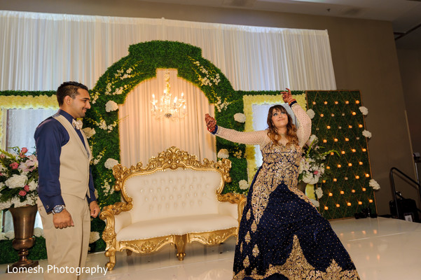 Bride and Groom at Wedding Reception in Dallas, TX Indian Wedding by Lomesh Photography