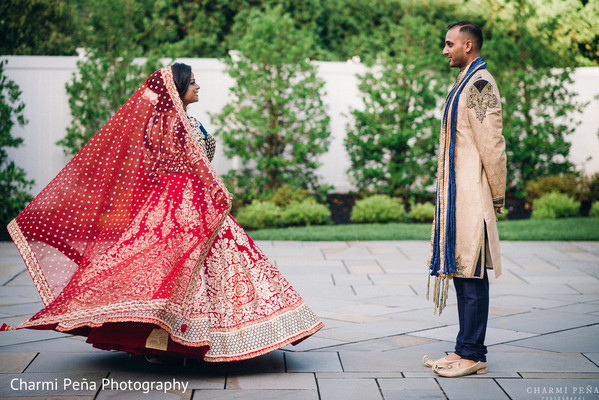 Huge red wedding lengha in Morristown, New Jersey Indian Wedding by Charmi Peña Photography
