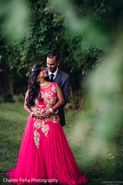Reception dress fuchsia in Morristown, New Jersey Indian Wedding by Charmi Peña Photography