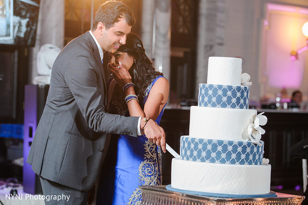 Bride and Groom Cake Cutting in Worcester, Massachusetts Indian Wedding by NYNJ Photography