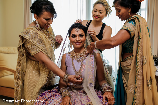 Beautiful Indian bride during hair & makeup in Cancun, MX Indian Wedding by DreamArt Photography