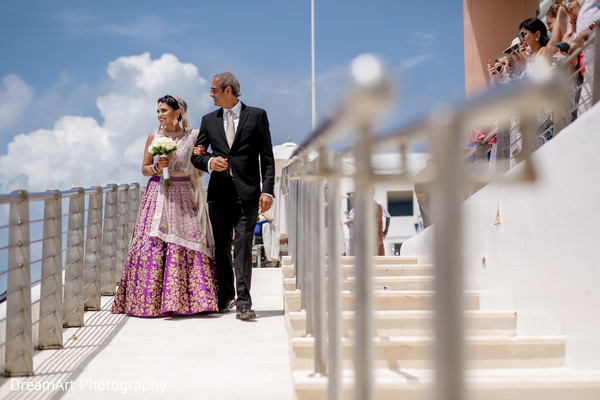 See the lovely Indian bride walking down the aisle in Cancun, MX Indian Wedding by DreamArt Photography