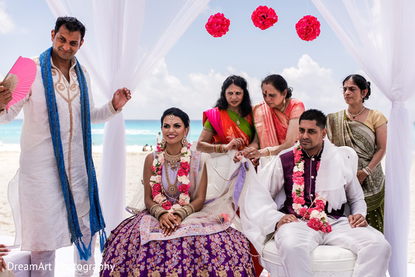 Our lovely Indian couple getting married by the ocean in Cancun, MX Indian Wedding by Dream Art Photography