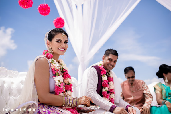 Lovely shot of this Indian couple in their wedding ceremony in Cancun, MX Indian Wedding by DreamArt Photography