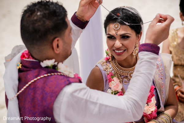 Beautiful makeup for this Indian bride in her wedding ceremony in Cancun, MX Indian Wedding by DreamArt Photography
