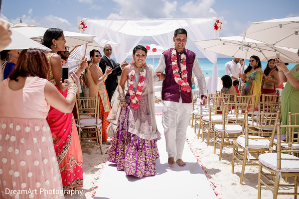 See the beautiful Indian couple walk the aisle as Mr. and Mrs. in Cancun, MX Indian Wedding by Dream Art Photography