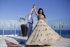 Handsome Indian groom showing off his beautiful Indian bride