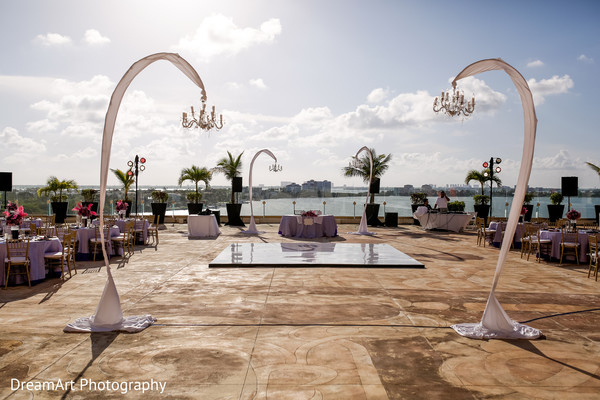 Beautiful Indian wedding reception set up by the ocean in Cancun, MX Indian Wedding by DreamArt Photography
