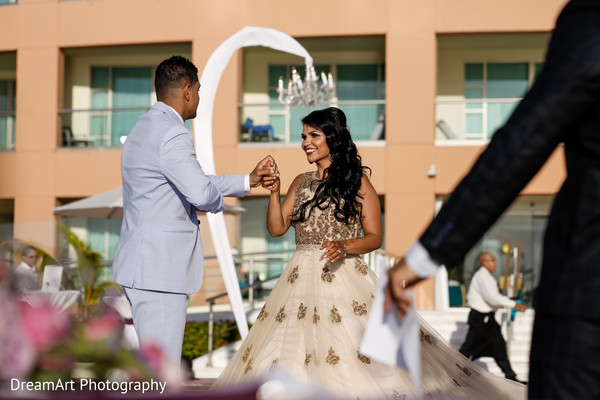 Indian couple having their first dance in Cancun, MX Indian Wedding by DreamArt Photography