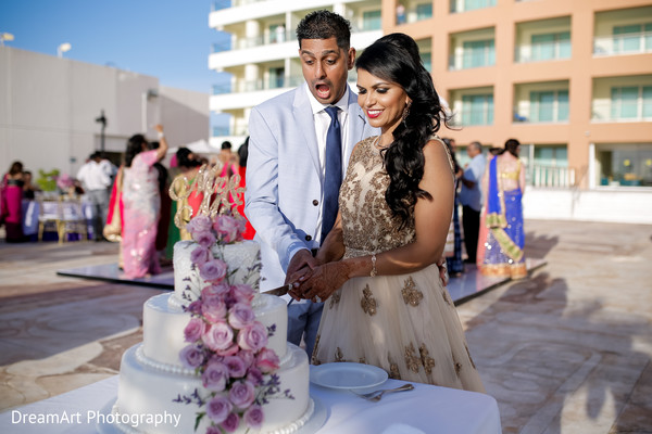 Stunning cake for this stunning Indian couple in Cancun, MX Indian Wedding by DreamArt Photography