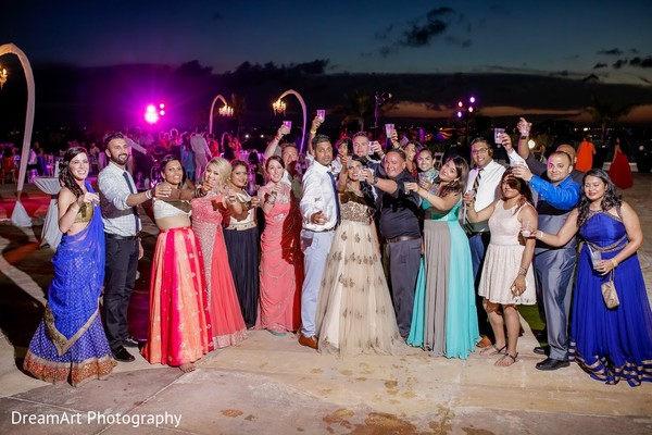 Cheers to the beautiful Indian couple! in Cancun, MX Indian Wedding by DreamArt Photography