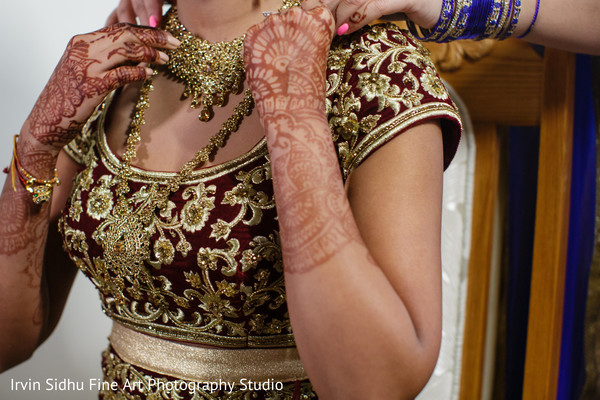Close up to a beautiful gold indian bridal jewelry set. in Brampton, ON Indian Wedding by Irvin Sidhu Fine Art Photography Studio