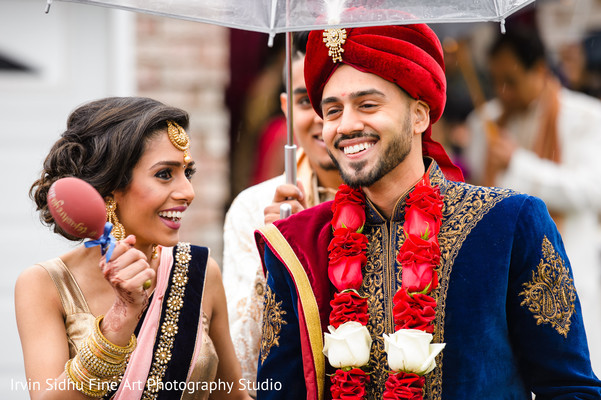 Grooms smiles with relatives moments before his baraat procession. in Brampton, ON Indian Wedding by Irvin Sidhu Fine Art Photography Studio