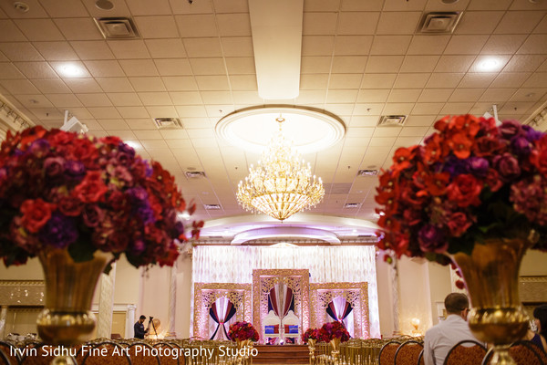 Central view of ceremony draped mandap stage. in Brampton, ON Indian Wedding by Irvin Sidhu Fine Art Photography Studio