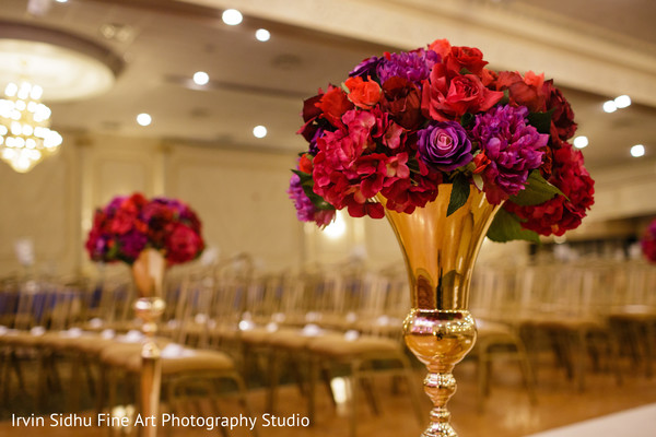 Fucsia and red flowers decorating the ceremony aisle. in Brampton, ON Indian Wedding by Irvin Sidhu Fine Art Photography Studio