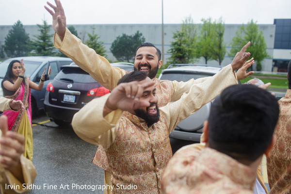 Indian groomsmen dancing in the baraat procession. in Brampton, ON Indian Wedding by Irvin Sidhu Fine Art Photography Studio