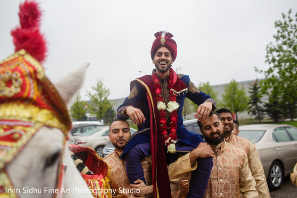 Indian Groomsmen carrying the groom on their shoulders. in Brampton, ON Indian Wedding by Irvin Sidhu Fine Art Photography Studio