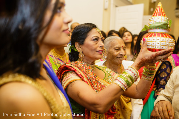 The bride's mother blessing the groom. in Brampton, ON Indian Wedding by Irvin Sidhu Fine Art Photography Studio