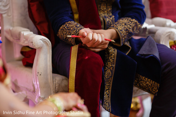 Indian groom during wedding ceremony traditions in Brampton, ON Indian Wedding by Irvin Sidhu Fine Art Photography Studio