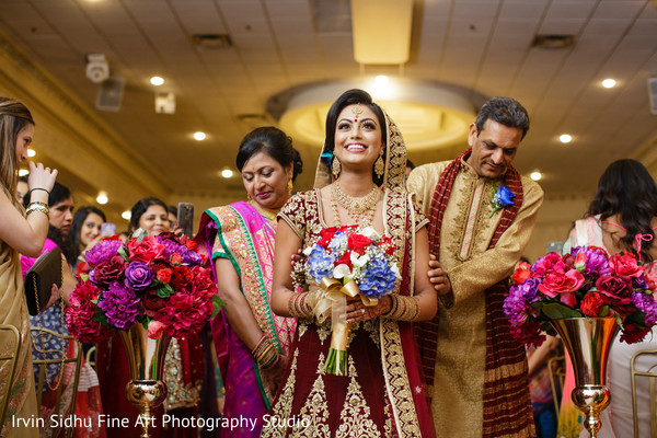 Beautiful indian bride walking down the aisle in Brampton, ON Indian Wedding by Irvin Sidhu Fine Art Photography Studio