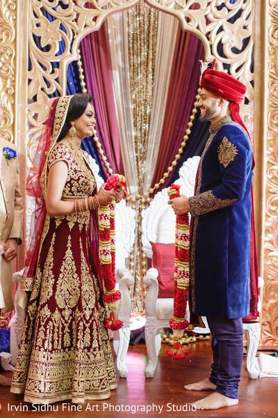 Indian couple exchanging their jaimalas in Brampton, ON Indian Wedding by Irvin Sidhu Fine Art Photography Studio