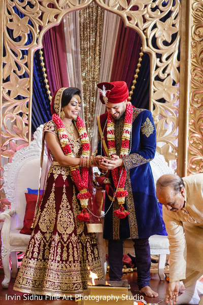 Look at this happy indian couple enjoy their wedding ceremony