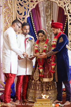 Indian couple while Aarti takes place
