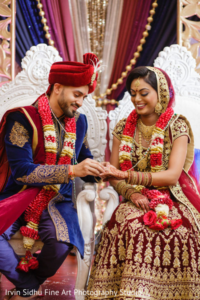 Indian groom giving the wedding ring to his bride in Brampton, ON Indian Wedding by Irvin Sidhu Fine Art Photography Studio